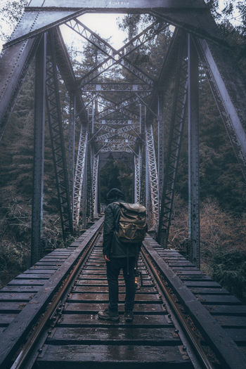 Bridge - Man Made Structure Connection Day Full Length One Person Outdoors People Rail Transportation Railing Railroad Track Real People Tree