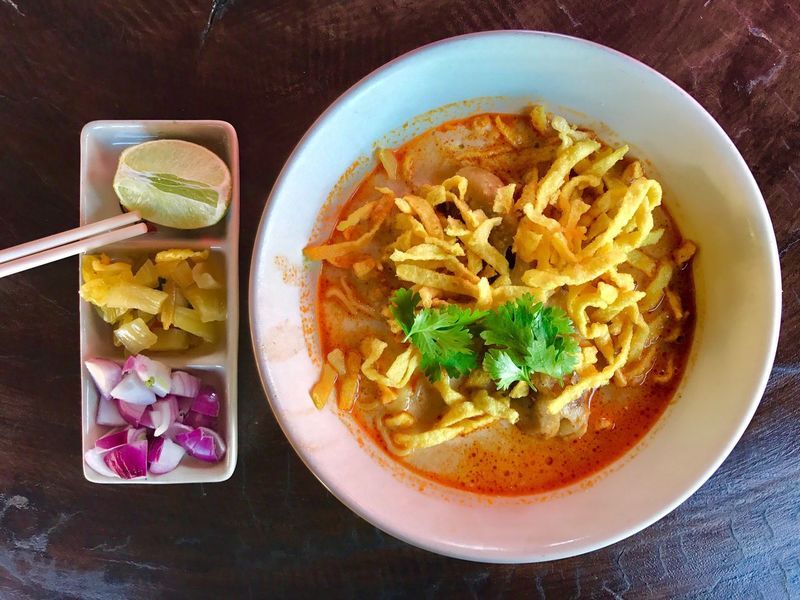 Khao Soy, local noodle with coconut milk soup from northern Thailand Food Ready-to-eat Table Healthy Eating Fast Food Food And Drink Khaosoy Noodle Coconut Milk Soup Cuisine North Thai Thailand Spicy Food Yellow Ingredient Lemon Crispy Chiangmai Chickens Beef Pork