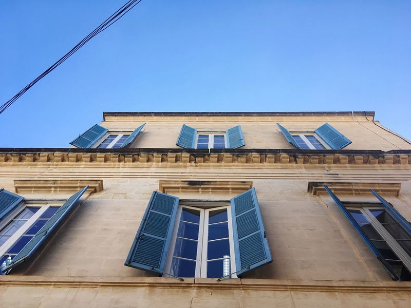Open Window Open Windows Open Windows... Malta Architecture Of South Europe Architecture Of Malta South Europe Maltese Architecture Architecture Built Structure Low Angle View Windows Clear Sky Building Exterior High Section Maltaphotography Malta City Residential Building Vacations South European Architecture