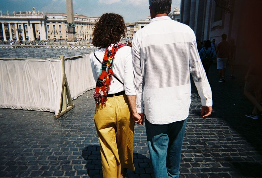 Parents in love Hand Holding Rome Vatican City Italy Real People Rear View Walking