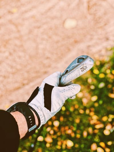 Close-up of hand holding golf club