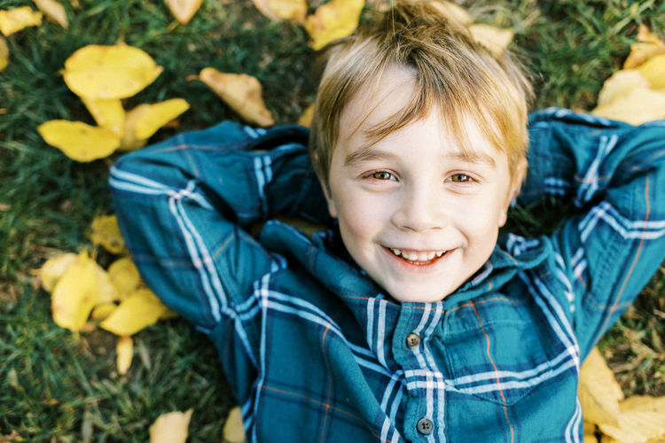 Portrait of smiling boy with autumn leaves