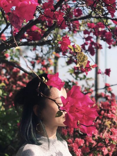 Spring. Sun. Breeze. Colorful Feeling Good Feeling Inspired Embrace Spring One Person Plant Real People Lifestyles Young Adult Women Inner Power Flower Flowering Plant Day Headshot Portrait Outdoors Inner Power