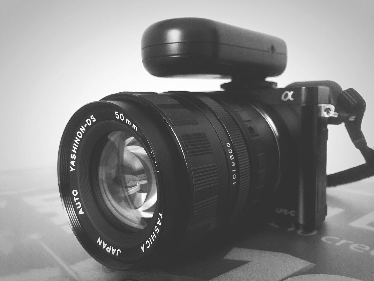 lens - optical instrument, camera - photographic equipment, photography themes, no people, digital camera, technology, camera, slr camera, close-up, digital single-lens reflex camera, photographing, day, film industry, modern, indoors