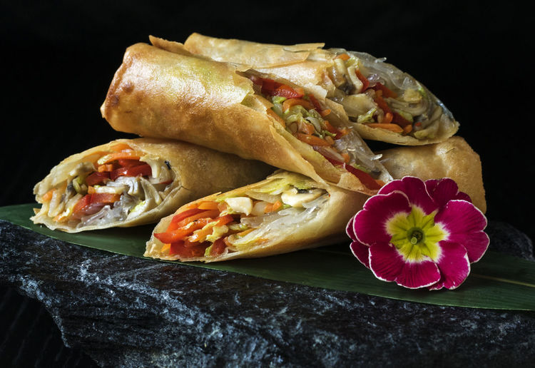 Asian-style Pancakes crunchy with vegetable filling, served on slate Asian  Asian-style Black Black Background Close-up Crunchy Filling Flower Food Freshness No People Pancakes Ready-to-eat Red Served Slate Stone Studio Shot Style Vegan Vegetable Vegeterian