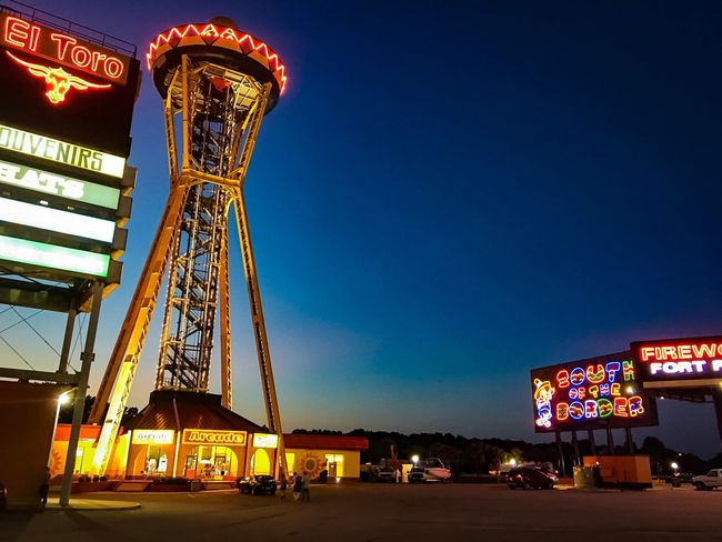 Night time at South of the Border in Dillon South Carolina. A popular roadside attraction! SouthOftheborder Amusement Park Night Illuminated Arts Culture And Entertainment Built Structure Architecture Text Communication Neon Outdoors Travel Destinations Amusement Park Building Exterior Nightlife Blue Clear Sky