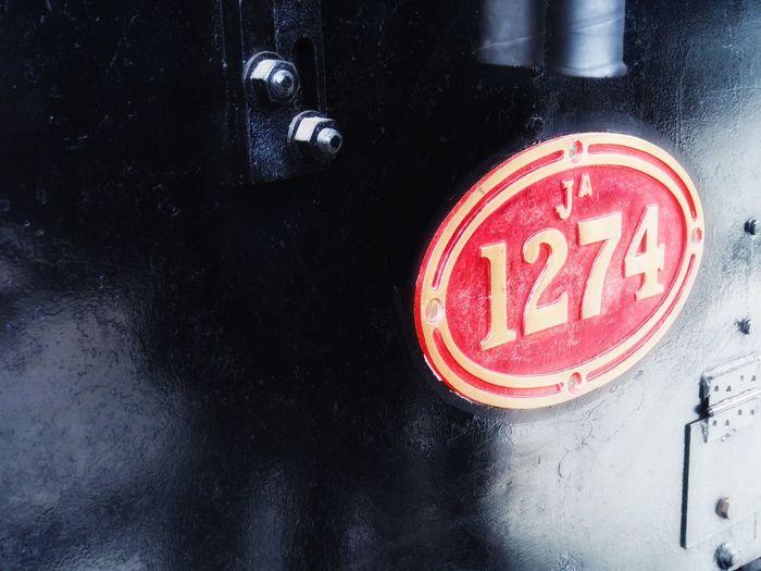 1234 Dunedin Black Train Warning Sign Western Script Close-up Red
