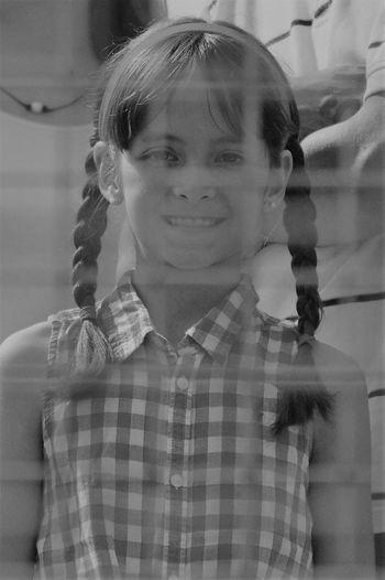 Portrait of smiling girl seen through net