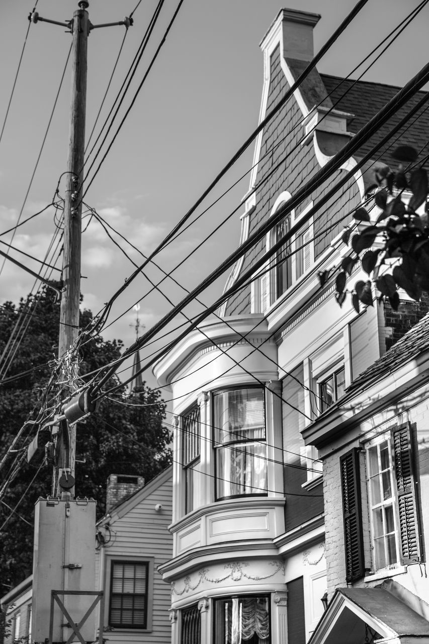 architecture, built structure, building exterior, building, cable, low angle view, sky, electricity, power line, no people, nature, city, residential district, technology, day, connection, outdoors, power supply, complexity, window