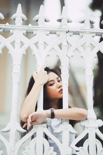 SHAMINE Singapore One Person Real People Architecture Young Adult Lifestyles Young Women Portrait Leisure Activity Focus On Foreground Built Structure Looking Headshot White Color Looking Away Day Railing Front View Standing Architectural Column Contemplation