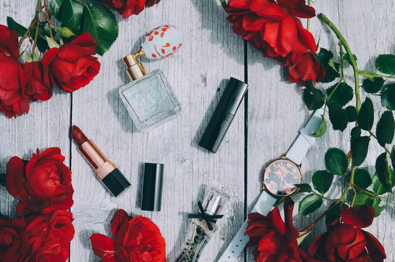 Beauty In Nature Close-up Container Cosmetics Directly Above Flower Flower Head Flowering Plant Freshness High Angle View Indoors  Large Group Of Objects Nature No People Parfum Petal Plant Publication Red Rosé Rose - Flower Still Life Summer Table Women The Still Life Photographer - 2018 EyeEm Awards The Creative - 2018 EyeEm Awards