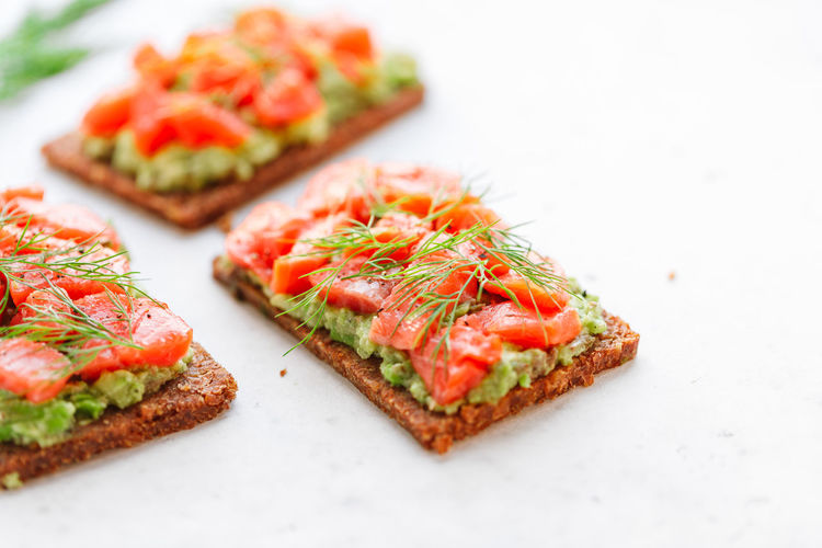 Food And Drink Food Bread Healthy Eating Freshness Vegetable Wellbeing Selective Focus Snack Sandwich Meal Close-up No People Fruit Ready-to-eat SLICE Appetizer Seafood Tomato Salmon - Seafood Herb Breakfast Dinner Tapas Dieting