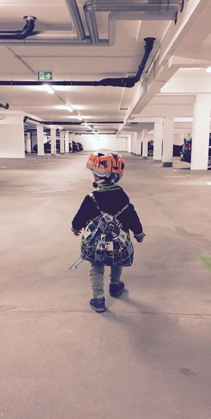 Let's Go. Together. Bycicle Helmet Going For A Ride  Kid Garage Backpack First Steps Indoors  Leisure Activity Childhood People Architecture Concretedesign Concrete Bycicle Rider One Person