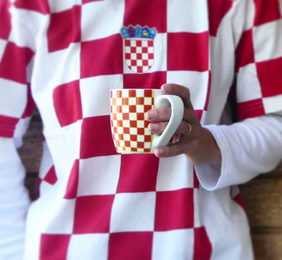 Coffee Croatia EyeEm Best Shots Football Football Fever Checked Pattern Close-up Coffee Cup Croatiafulloflife Fan - Enthusiast Flag Hand Holding Leisure Activity Midsection One Person Patriotism Pattern Red Soccer Soccer Uniform Sport Sports Sports Clothing White Color