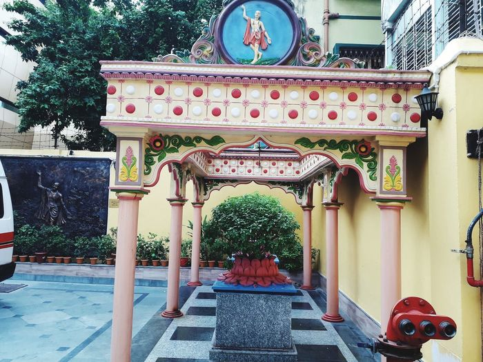 Entrance of temple against building