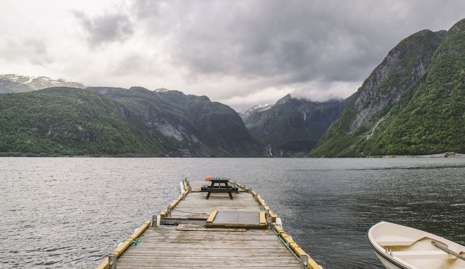 Sundal, Norway Nature Norway Norway🇳🇴 Sundal Boat Boat Bridge Cloud - Sky Day Fishing Fishing Boat Lake Landing Stage Mountain Mountain Range Nature Nautical Vessel No People Norway Nature Outdoors Sky Tranquil Scene Tranquility Transportation Tree Water