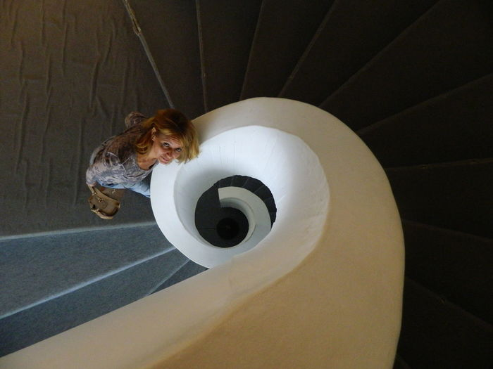 High angle portrait of woman standing on staircase