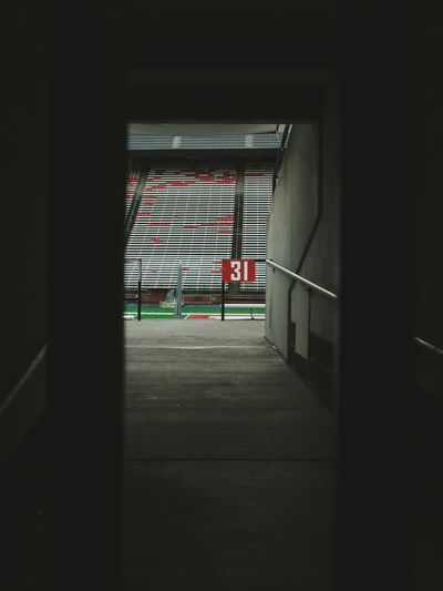 Built Structure Entrance No People Architecture Tunnel Fans Fan Team Team Sports Sports College Football Sport Empty Natural Light Light And Shadow Tunnel Vision Crimson Stadium Atmosphere Stadium Seating Colliseum Stadium 31 Destination Point Of Interest