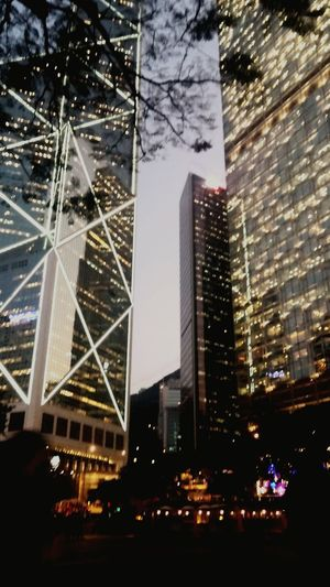 Skyscrapers. I Urban Landscape Skyscrapers Silhouettes Blury Lights Focus Interior Exterior Design Cubicles Architecture Focus Blur Overlapping Beams Vague Wayofliving Busy City HongKong Adapted To The City