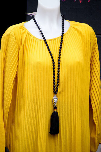 Close-up of yellow clothing in mannequin