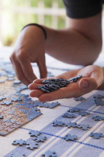 Day Focus On Foreground Hand Holding Holiday Holidays Person Playing Puzzle  Puzzle Time Puzzles