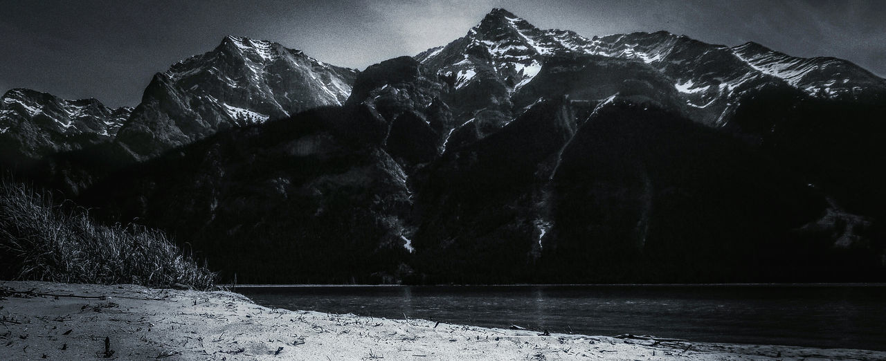 Mountains Mountain Addict Lake Beach Nature EyeEm Nature Lover Black Black And White Beach Sand Beach Grass Canadian Rockies  Snow Capped Mountains Geological Detail The Great Outdoors - 2016 EyeEm Awards