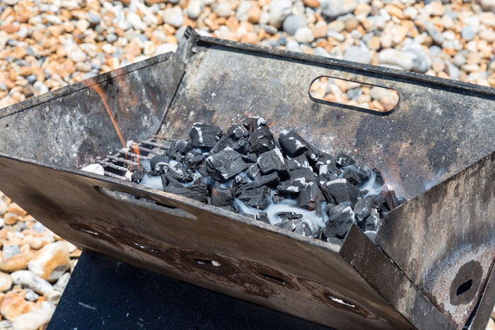Smouldering Barbecue Coals Al Fresco Barbecue Barbecue Grill BBQ Charcoal Close-up Coals Cooking Day Food And Drink Grill Metal No People Outdoors Rusty Smouldering