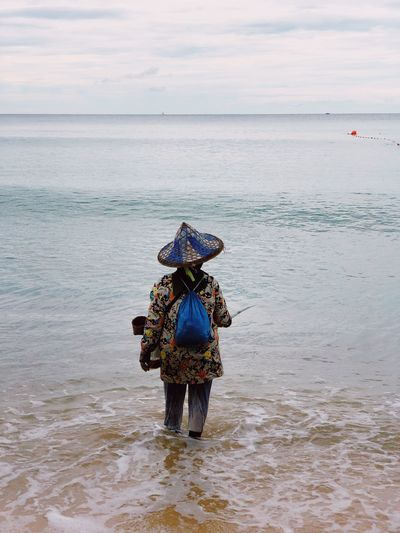 Thai woman fishing by the sea. 12.2018 Thailand By The Sea Fishingman Fishing Life Fishing Thai Woman Relaxing Landscape_Collection Water Sea Sky Land Beauty In Nature Beach Nature Scenics - Nature Horizon Over Water Day Lifestyles Leisure Activity International Women's Day 2019
