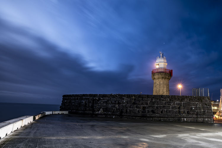 Dunmore East Sky Architecture Built Structure Building Exterior Cloud - Sky Lighthouse Tower Direction Building Illuminated Water Guidance Sea Night Nature Protection No People History Dusk Outdoors