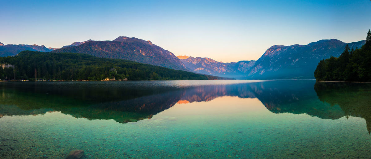 Lake Bohinj at sunrise Beauty In Nature Beauty In Nature Dawn Effect Idyllic Lake Landscape Majestic Mirror Mountain Mountain Range Nature Outdoors Panoramic Power In Nature Reflection Scenics Slovenia Sunrise Symmetry Tranquil Scene Tranquility
