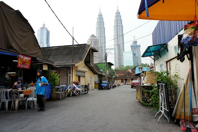 Kampong Baru in Kuala Lumpur is an old traditional Malay village trapped in the middle of an ever expanding city. Kampung Baru Kuala Lumpur Kualalumpur Petronas Twin Towers Petronas Petronas Towers  Petronastwintowers Klcc Kuala Lumpur City Center New Meets Old Old Meets New Urban Development Urban Landscape Urbanphotography Urbanscapes Newstrekker Gettylicious City Life City Landscape Streetphotography