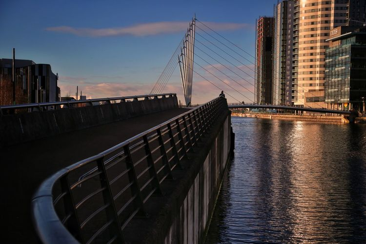Salford Quays Salford Quays Manchester Bridge - Man Made Structure Millenium Bridge Architecture Built Structure Sky Water Bridge Building Exterior City Sunset Transportation Connection Railing Nature Engineering Cloud - Sky Reflection River Building Office Building Exterior Skyscraper