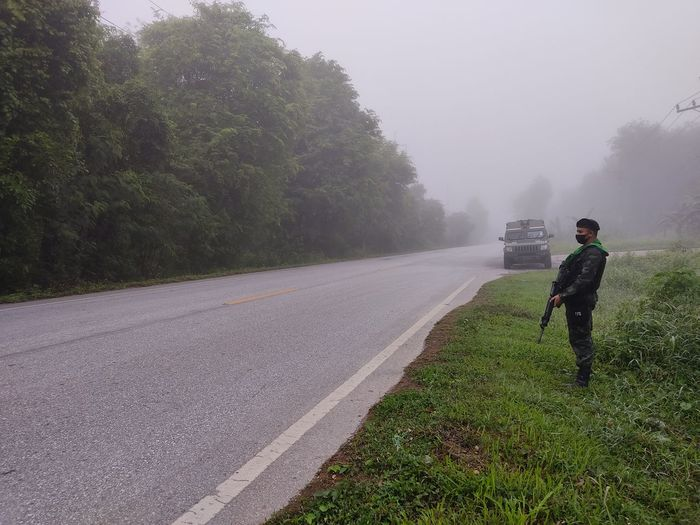 Army soldier standing by road