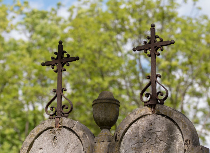 Low angle view of crosses at cemetery