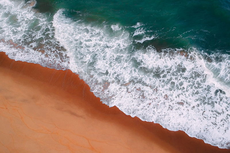 aerial view of sea waves water texture background Sea Water Wave Sport Motion Aquatic Sport Beauty In Nature Surfing Beach Power In Nature Nature Land High Angle View Scenics - Nature Power Day Outdoors Breaking