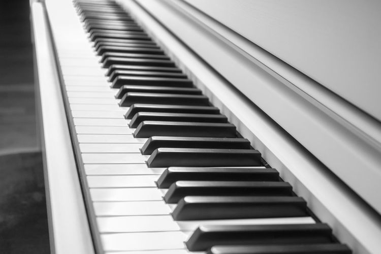 Arts Culture And Entertainment Black Color Close-up Day Diminishing Perspective Focus On Foreground High Angle View In A Row Indoors  Keyboard Instrument Music Musical Equipment Musical Instrument No People Pattern Piano Piano Key Repetition Selective Focus Simplicity White Color