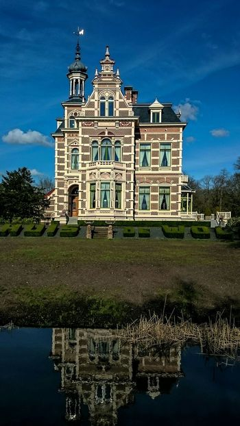 Monumental  Countryhouse 't Huis de Wolf, build in 1892 in Neo Renaissance style. Golden Hour Architecturelovers, Water Reflections