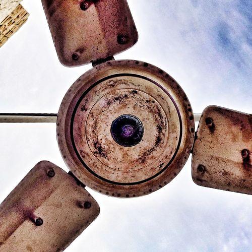 Low angle view of rusty wheel