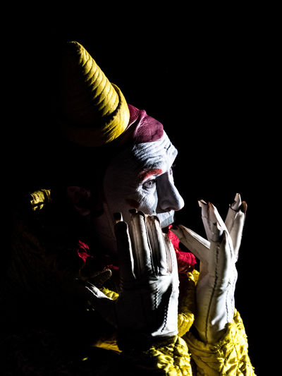Clown Gensi Clown Gensi Fresh On Eyeem  Hands Music Show Black Background Close-up Clown Costume Culture Entertainment Fingers Gensi Gloves Gold Colored Indoors  Make Up Portrait Roncalli Stage Costume Whistle The Week On EyeEm