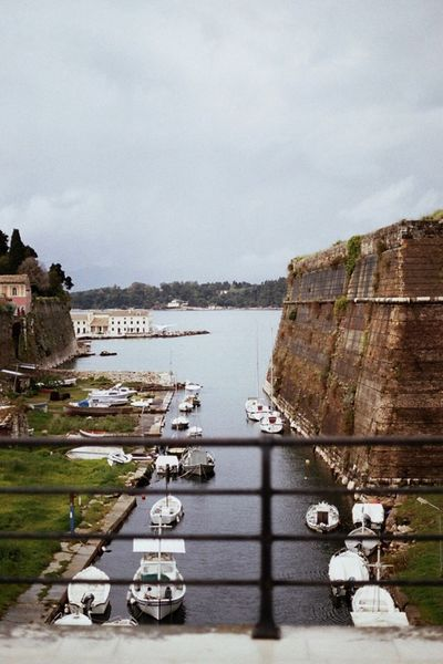 Old Fortress Bridge, Corfu, Travel Destinations Corfu Island Boats Built Structure Water Sea Greece No People Day Outdoors Transportation Tranquility Expired Film Filmisnotdead Analogue Photography Film Photography EyeEm Gallery Architecture Old Fortress Wall Fortress Building Exterior Outdoors Photograpghy  Overcast