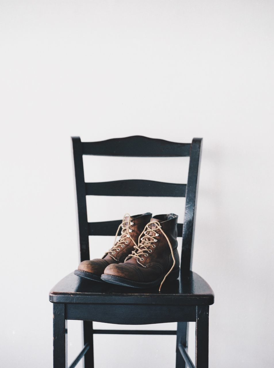 Shoes On Chair Against White Background