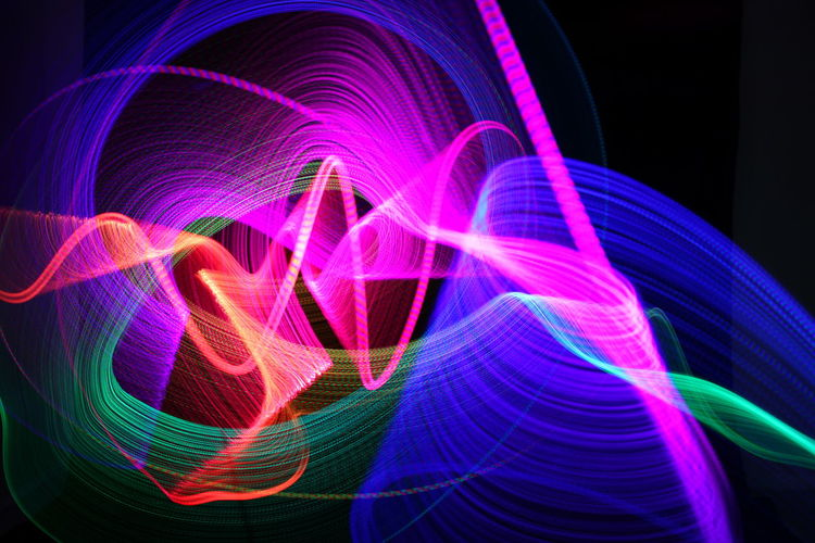 Multi Colored Motion Illuminated Long Exposure Black Background Abstract Technology Purple Light Flowing Futuristic Vibrant Color No People Light - Natural Phenomenon Studio Shot Creativity Speed Connection Pattern Light Trail Indoors  Neon Glowing Complexity