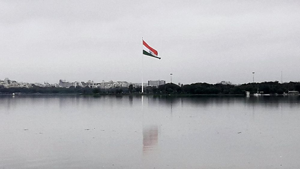 Longest flag in India Flag Identity Patriotism Water National Flag Flying Flag Pole Sky No People Sea Tranquil Scene Fluttering Scenics Waterfront