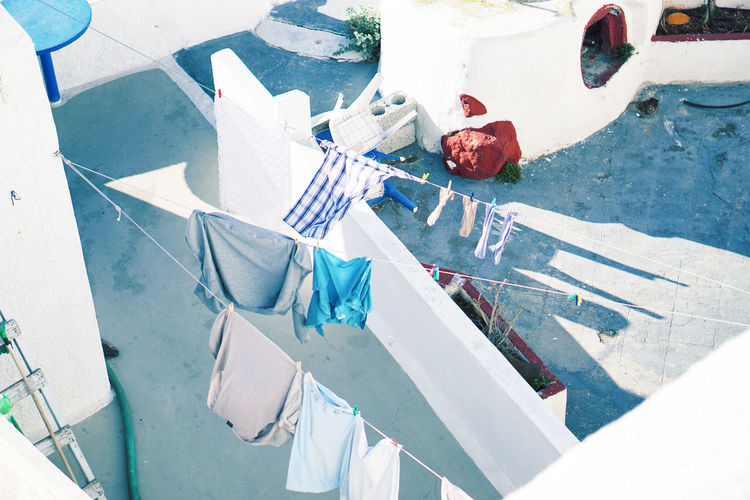 High angle view of clothes hanging on clothesline at building terrace