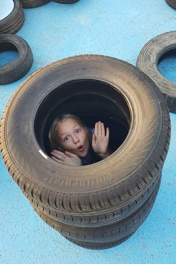 Ku Ku Tire Wheel Child Childhood Kuku Playing Game Hands Blue Outdoors Outdoor Photography Outdoor Zaragoza Zaragoza City SPAIN The Mobile Photographer - 2019 EyeEm Awards