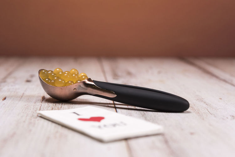 Icecream spoon with yellow fruits Close-up Day EyeEm EyeEm Best Shots EyeEmNewHere Food Fruit Hand Tool I Love You Tissue Icecream Spoons Indoors  Kitchen Knife Love No People Paper Spoon Still Life Table Tissue Wood - Material