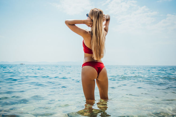 Sky Water Sea One Person Leisure Activity Lifestyles Young Adult Clothing Horizon Real People Swimwear Bikini Hair Horizon Over Water Scenics - Nature Beauty In Nature Women Young Women Holiday Hairstyle Beautiful Woman Outdoors