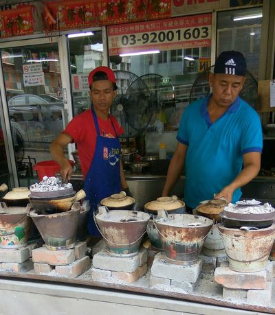 Business Occupation Men Adult Food Real People Food And Drink Malaysianfood Hungry Yet? The Week Of Eyeem Busy At Work Claypot Food Claypotchickenrice Charcoal Fire