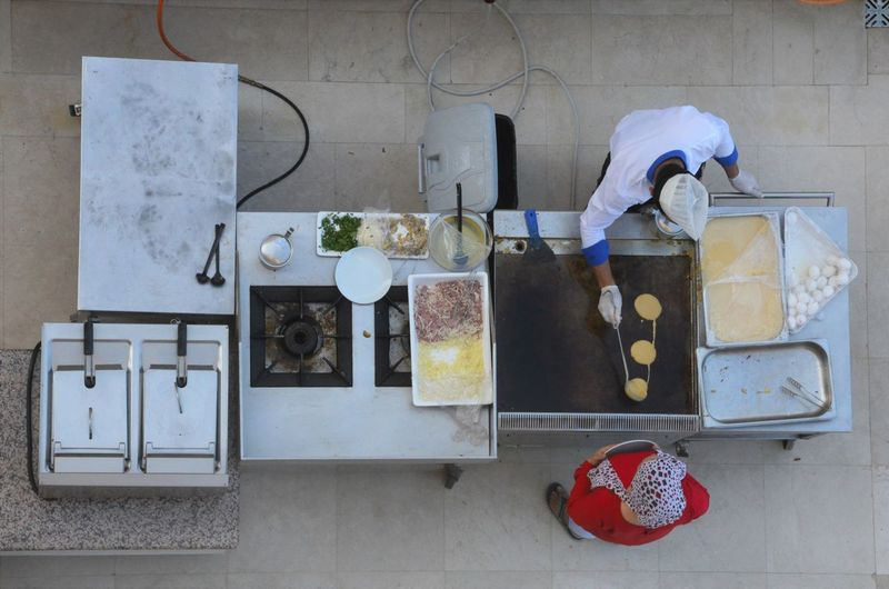 Directly Above Shot Of Chef Preparing Pancakes In Kitchen At Restaurant