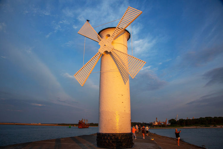 Baltic Sea Stawa Mlyny Alternative Energy Architecture Building Exterior Built Structure Cloud - Sky Environment Environmental Conservation Fuel And Power Generation Incidental People Men Nature Outdoors Renewable Energy Sea Sky Sunset Turbine Water Wind Power Wind Turbine